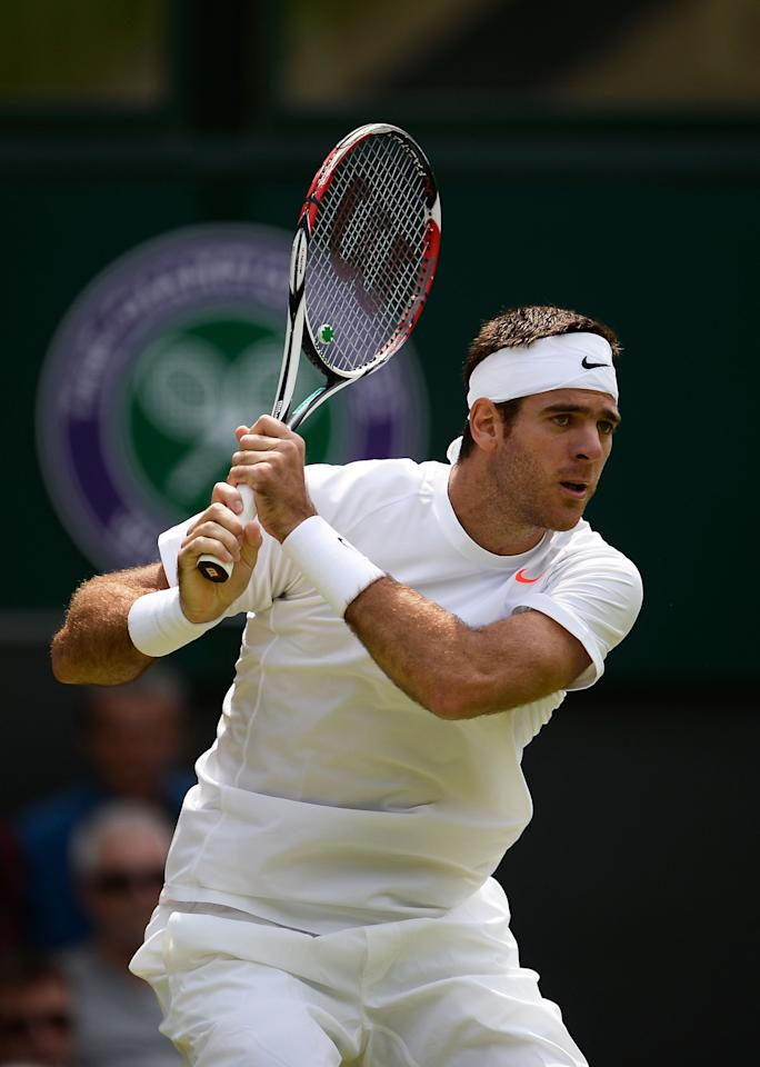 LONDON, ENGLAND - JUNE 27: Juan Martin Del Potro of Argentina plays a backhand during his Gentlemen's Singles second round match against Jesse Levine of Canada on day four of the Wimbledon Lawn Tennis Championships at the All England Lawn Tennis and Croquet Club on June 27, 2013 in London, England. (Photo by Dennis Grombkowski/Getty Images)