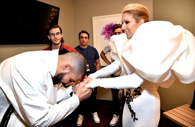<p>Drake is such a big fan of Celine Dion that he had to bow down to the Canadian queen when he met her backstage at the Billboard Music Awards. (Photo: Kevin Mazur/BBMA2017/Getty Images for DCP) </p>