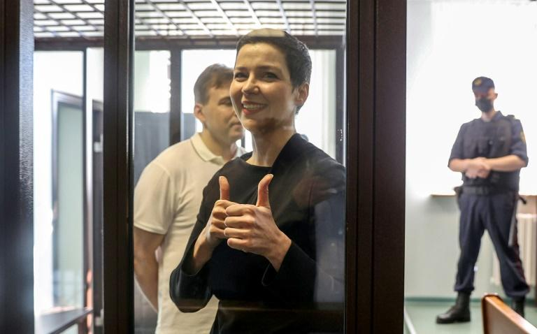 Maria Kolesnikova, the last remaining protest leader still in Belarus, gives the thumbs up from her defendant's cage as her trial begins in Minsk
