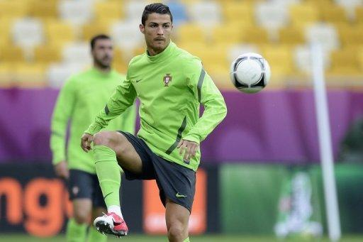 Portugal's greatest weapon is Real Madrid star Cristiano Ronaldo, seen here at a training session on June 8, whose haul of 46 Spanish league goals last season was bettered only by Barcelona's Lionel Messi, who finished with a tally of 50