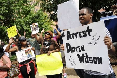 Protestors at the St. Louis County Justice Center call for the arrest of Police Officer Darren Wilson in Clayton, Missouri in this August 20, 2014 file photo. REUTERS/Mark Kauzlarich