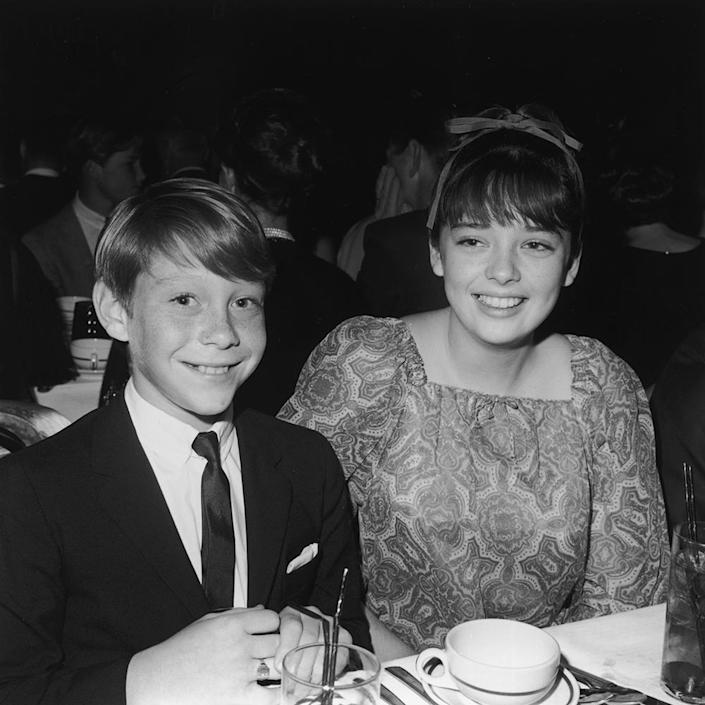 """American actor Bill Mumy and British actor Angela Cartwright, stars of the television show 'Lost In Space,' attend the Spotlighters Teen Awards dinner, circa 1966. <span class=""""copyright"""">Max B. Miller/Fotos International/Getty Images</span>"""