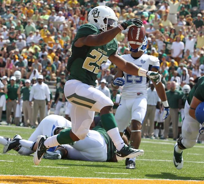 Baylor running back Lache Seastrunk (25) scores past Buffalo in the first half of an NCAA college football game, Saturday, Sept., 7, 2013, in Waco, Texas. (AP Photo/Waco Tribune Herald, Jerry Larson)