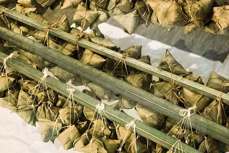 Rows of cooked rice dumplings or 'zongzi.'