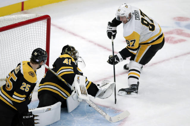 Boston Bruins goaltender Jaroslav Halak (41) makes a save on a shot by Pittsburgh Penguins center Sidney Crosby (87) during the first period of an NHL hockey game in Boston, Monday, Nov. 4, 2019. (AP Photo/Charles Krupa)