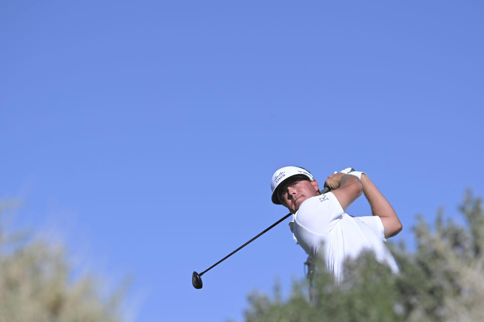 Keith Mitchell plays his tee shot on the 17th hole during first round of the CJ Cup golf tournament Thursday, Oct. 14, 2021, in Las Vegas. (AP Photo/David Becker)
