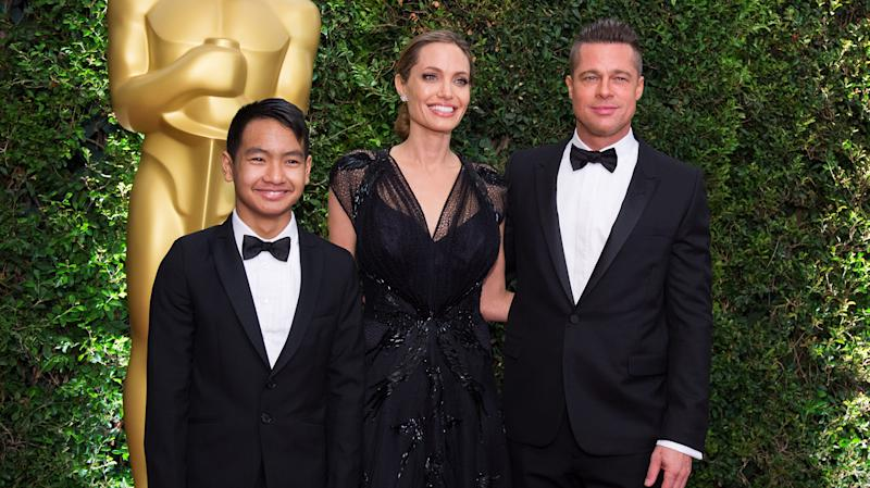 Angelina Jolie (left), son Maddox Jolie-Pitt (right) and actor Brad Pitt attend the 5th Annual Governors Awards