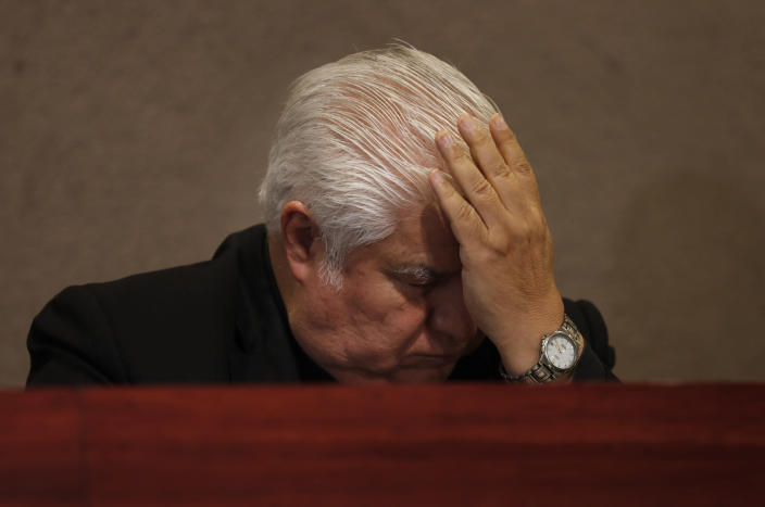 "In this Jan. 14, 2020 photo, Rogelio Cabrera, president of the Mexican bishops conference, takes his hand to his forehead after speaking during a news conference in Mexico City. The Mexican bishops conference ended its silence about the Legion of Christ to denounce the new revelations and the Legion's failure to provide ""a specific act of justice or reparation for the victims"" even after it acknowledged the crimes. (AP Photo/Marco Ugarte)"