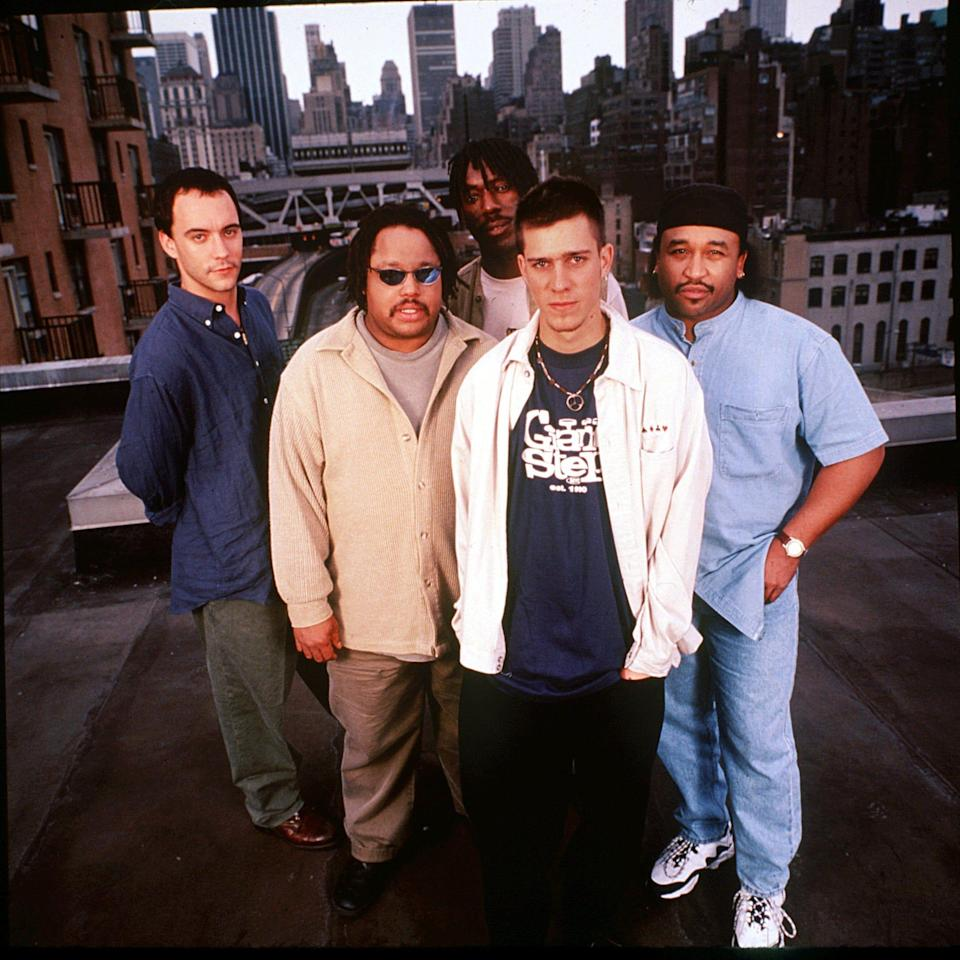 """An early image of Dave Matthews Band members Dave Matthews, left, Leroi Moore, Boyd Tinsley, Stefan Lessard and Carter Beauford. The group released its sophomore album, """"Crash,"""" in 1996."""