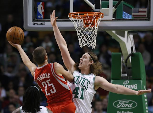 Houston Rockets small forward Chandler Parsons (25) drives to the hoop against Boston Celtics center Kelly Olynyk (41) in the first half of an NBA basketball game in Boston, Monday, Jan. 13, 2014. (AP Photo/Elise Amendola)