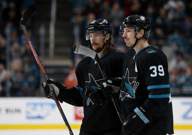 San Jose Sharks' Erik Karlsson (65), celebrate with Logan Couture (39), who scored a goal against the Vancouver Canucks during the first period of an NHL hockey game in San Jose, Calif., Friday, Nov. 23, 2018. (AP Photo/Josie Lepe)