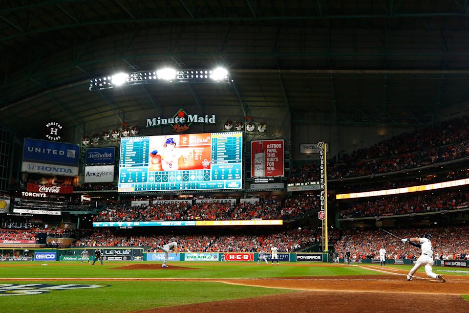 A Houston Astros fan was removed from their game on Saturday for holding up a domestic violence awareness sign in the stands. (Getty Images)