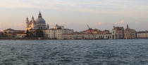 """FILE - This Nov. 9, 2013 file photo shows the Basilica di Santa Maria della Salute (St. Mary of Health) at sunset as seen from the water to the south. The church, built after plague broke out in the 17th century, is a fixture of the city's skyline. Venice's central place in the history of battling pandemics and pestilence will come into focus at this year's Venice Film Festival, which opens Wednesday, Sept. 1, 2021, with the premiere of Pedro Almodovar's in-competition """"Madres Paralelas"""" (Parallel Mothers), which he developed during Spain's 2020 coronavirus lockdown, one of the harshest in the West. (AP Photo/Michelle Locke)"""