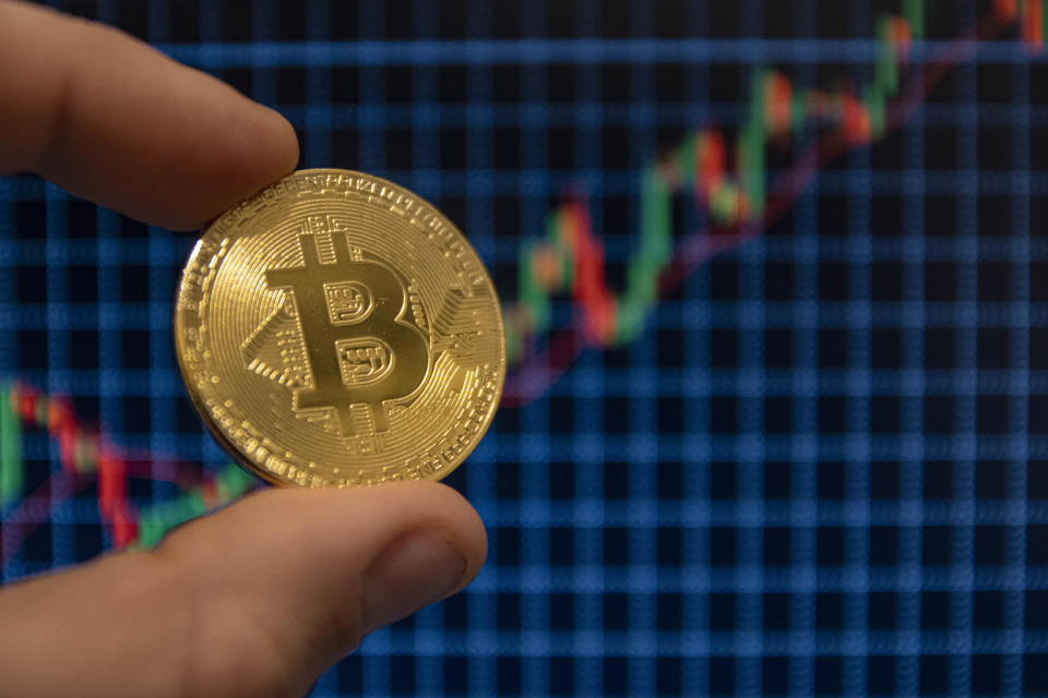 In this photo illustration, the Bitcoin golden cryptocurrency commemorative coin seen displayed. (Photo by Nik Oiko / SOPA Images/Sipa USA)