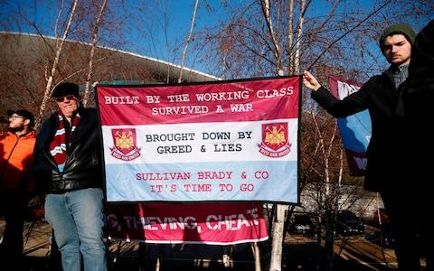 Fans demonstate against the owners of West Ham United, ahead of the English Premier League football match between West Ham United and Everton - Credit: AFP