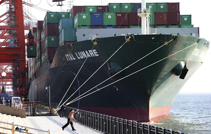 A container ship is docked at a port in Tokyo, Monday, Jan. 27, 2014. Japan's trade deficit surged to a record 11.47 trillion yen ($112 billion) in 2013 as the shutdown of nuclear power plants swelled the nation's energy import bill. Provisional data Monday showed that exports rose 9.5 percent to 69.8 trillion yen ($680.9 billion), while imports jumped 15 percent to 81.3 trillion yen ($793.2 billion). (AP Photo/Koji Sasahara)