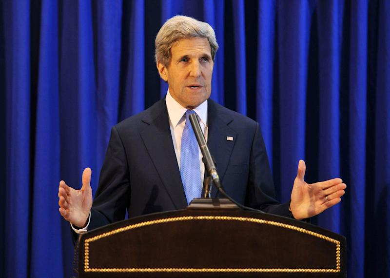 """U.S. Secretary of State John Kerry speaks during a press conference at Queen Alia International Airport on Friday, July 19, 2013. Kerry says Israel and the Palestinians will meet soon in Washington to finalize an agreement on relaunching peace negotiations for the first time in five years. Kerry has told reporters that he and the two sides """"reached an agreement that establishes a basis for direct final status negotiations,"""" but he added that it is """"still in the process of being formalized."""" The announcement Friday came at the end of a visit by Kerry to the region holding several days of talks with both sides. (AP Photo/Mandel Ngan, Pool)"""