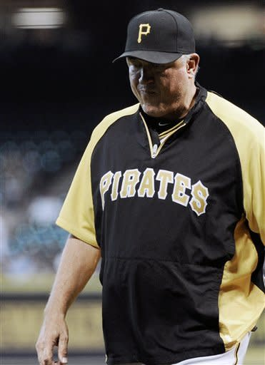 Pittsburgh Pirates manager Clint Hurdle walks off the field after being ejected by first base umpire Tim Timmons after arguing a close play against the Houston Astros in the second inning of a baseball game on Saturday, Sept. 22, 2012, in Houston. (AP Photo/Pat Sullivan)