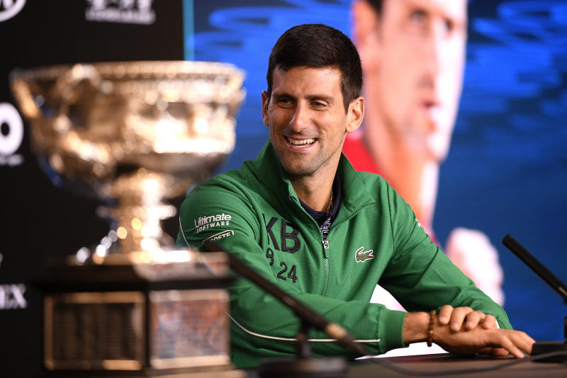 Serbia's Novak Djokovic addresses a press conference after defeating Austria's Dominic Thiem to win the men's singles final at the Australian Open tennis championship in Melbourne, Australia, Monday, Feb. 3, 2020. (AP Photo/Andy Brownbill)