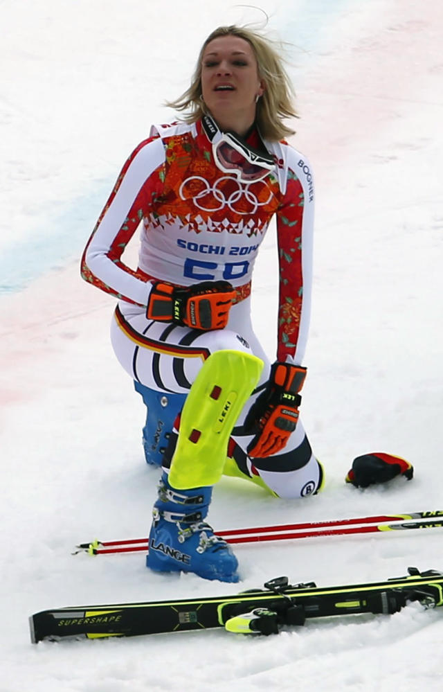 Germany's Maria Hoefl-Riesch kneels in the snow after the slalom run of the women's alpine skiing super combined event at the 2014 Sochi Winter Olympics at the Rosa Khutor Alpine Center February 10, 2014. Hoefl-Riesch came in first place. REUTERS/Dominic Ebenbichler (RUSSIA - Tags: SPORT SKIING OLYMPICS)