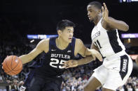Butler forward Christian David (25) drives against Providence guard Alpha Diallo (11) during the first half of an NCAA college basketball game Friday, Jan. 10, 2020, in Providence, R.I. (AP Photo/Elise Amendola)