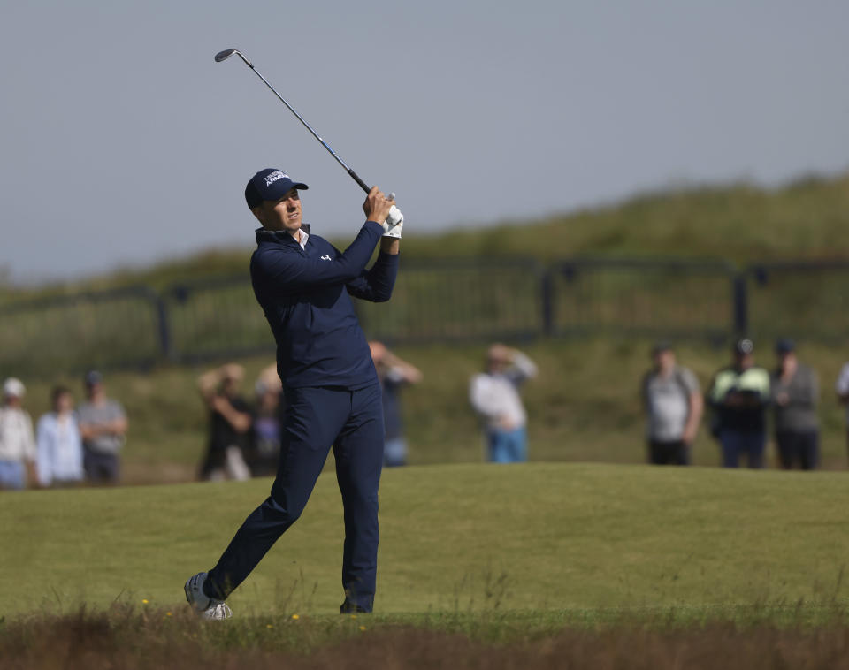 United States' Jordan Spieth playa a shot on the 1st fairway during the first round British Open Golf Championship at Royal St George's golf course Sandwich, England, Thursday, July 15, 2021. (AP Photo/Ian Walton)