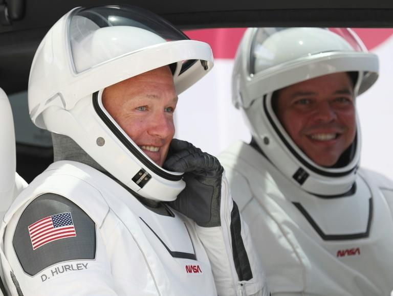 In this file photo taken on May 30, 2020 NASA astronauts Bob Behnken (R) and Doug Hurley prepare for lift-off to the International Space Station (AFP Photo/JOE RAEDLE)