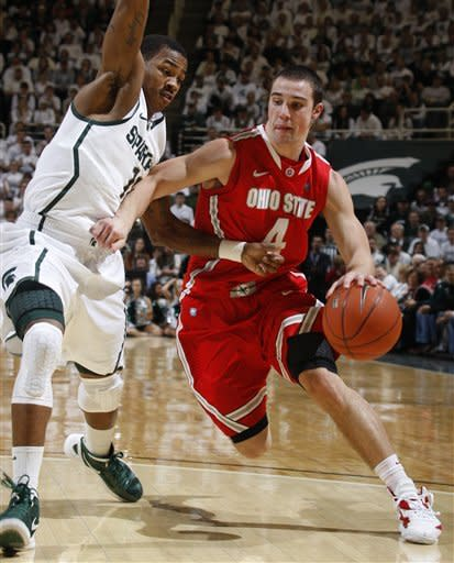 Ohio State's Aaron Craft, right, drives against Michigan State's Keith Appling during the first half of an NCAA college basketball game, Sunday, March 4, 2012, in East Lansing, Mich. (AP Photo/Al Goldis)