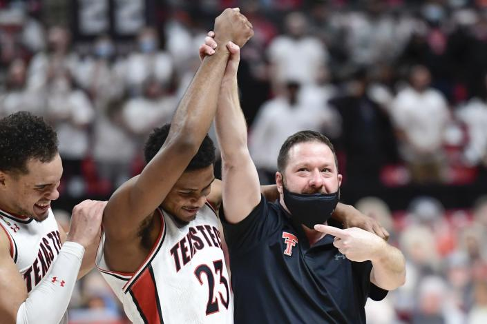 Texas Tech head coach Chris Beard points to Chibuzo Agbo (23) after an NCAA college basketball game against Texas in Lubbock, Texas, Saturday, Feb. 27, 2021. (AP Photo/Justin Rex)