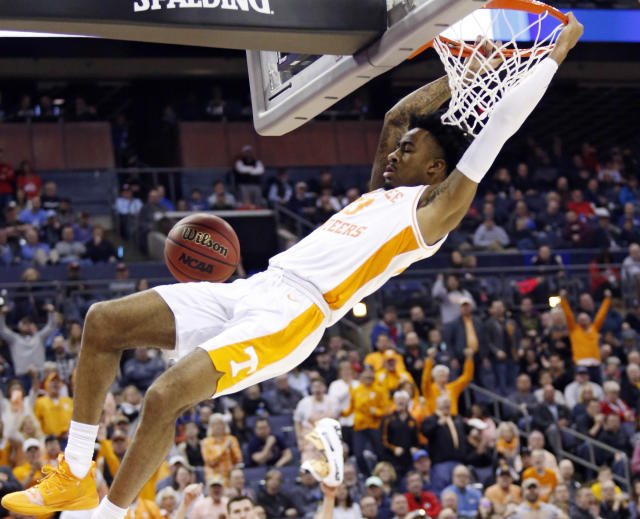 Tennessee's Jordan Bowden dunks the ball against Colgate in the second half of a first-round game in the NCAA mens college basketball tournament in Columbus, Ohio, Friday, March 22, 2019. Tennessee won 77-70. (AP Photo/Paul Vernon)
