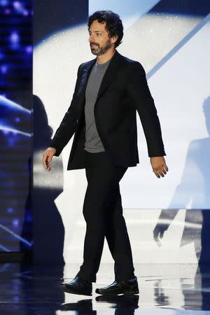 Google Inc. co-founder Sergey Brin walks on stage during the second annual Breakthrough Prize Awards at the NASA Ames Research Center in Mountain View, California, November 9, 2014. REUTERS/Stephen Lam