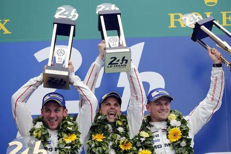 Porsche 919 Hybrid number 19 driver Tandy of Britain, Bamber of New Zeland, and Hulkenberg of Germany celebrate on the podium after winning the Le Mans 24-hour sportscar race in Le Mans, central France