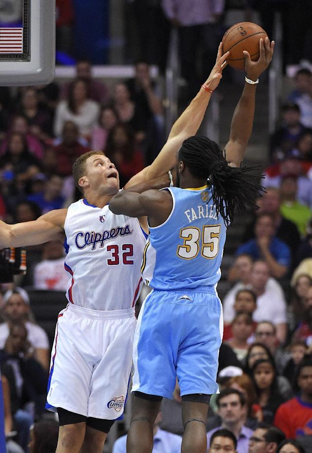 Denver Nuggets forward Kenneth Faried, right, shoots as Los Angeles Clippers forward Blake Griffin defends during the first half of an NBA basketball game, Tuesday, April 15, 2014, in Los Angeles. (AP Photo/Mark J. Terrill)