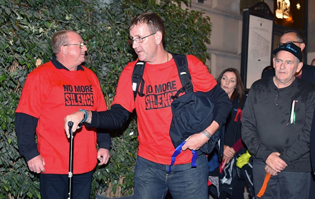 Paul Levely (C) and other survivors of abuse by Catholic clergy in Australia arrive at the Quirinale hotel in Rome on February 28, 2016 to hear evidence from Cardinal George Pell.