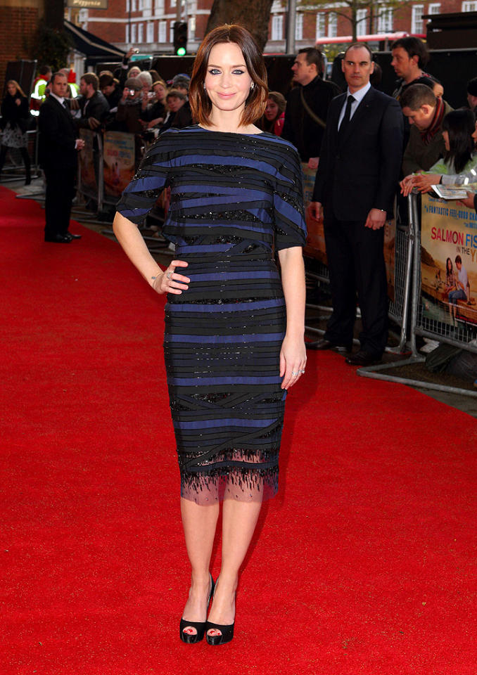 "Also spotted in Louboutin peep-toes was Brit beauty Emily Blunt, who paired her black satin heels with a Carolina Herrera dress and Tiffany & Co. baubles for the U.K. premiere of her latest project, <a target=""_blank"" href=""http://movies.yahoo.com/movie/salmon-fishing-in-the-yemen/"">""Salmon Fishing in the Yemen.""</a> The film's title may be atrocious, but we absolutely adore this actress and her sophisticated personal style. (4/10/2012)"