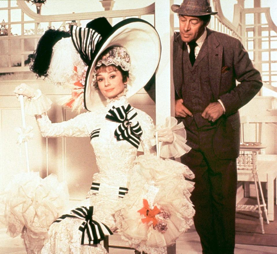 "Eliza (Audrey Hepburn) gets a makeover courtesy of Henry Higgins (Rex Harrison) in ""My Fair Lady."""