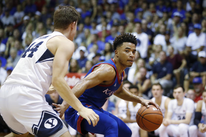 Kansas guard Devon Dotson (1) tries to get around BYU guard Connor Harding (44) on Nov. 26, 2019, in Lahaina, Hawaii. (AP Photo/Marco Garcia)