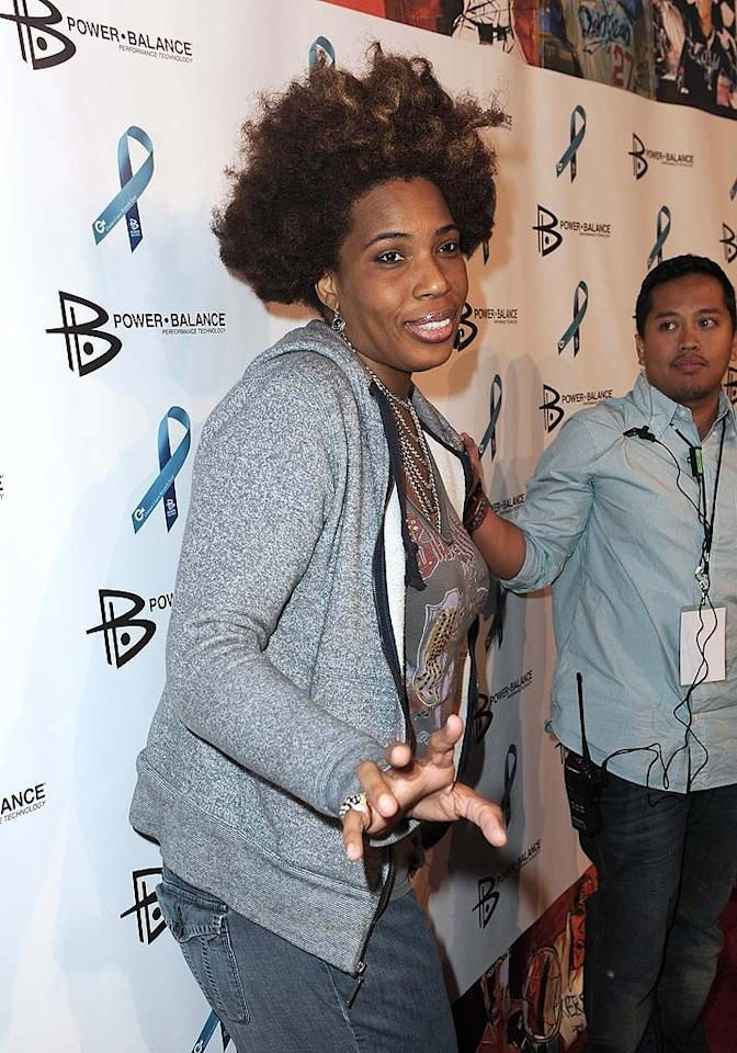 """Singer Macy Gray, who's been back in the spotlight with a new album, <i>The Sellout</i>, rocked denim and her signature funky 'do. Jordan Strauss/<a href=""""http://www.wireimage.com"""" target=""""new"""">WireImage.com</a> - August 3, 2010"""