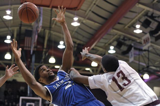 Saint Louis' Dwayne Evans, left,reaches for a rebound over Saint Joseph's Ronald Roberts Jr. (13) during the first half of an NCAA college basketball game Wednesday, Feb. 5, 2014, in Philadelphia. (AP Photo/Michael Perez)