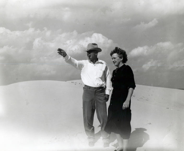 """This undated family photo provided by Ashley Williams Watt shows Watt's great-grandfather, Glen Joseph Allen, and his wife, Helen, surveying land in West Texas. Allen was a cow buyer in Fort Worth and eventually moved to sandy terrain in the Permian Basin to raise cattle. His great-granddaughter, Ashley Williams Watt, is carrying on in their tradition — but worries that pollution from abandoned oil wells on some of her land may threaten the legacy. """"What if that history ends with me?"""" Watt says. (Watt Family via AP)"""