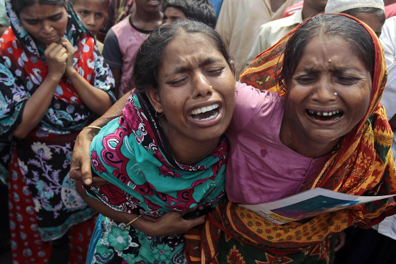 Bangladeshi women cry for their missing relatives during a prayer ceremony for the souls of the 1,127 people who died in a garment building structure collapse last month, in Savar, near Bangladesh, Tuesday, May 14, 2013. The Islamic prayer service was held a day after the army ended the nearly three-week, painstaking search for bodies among the rubble of the worst tragedy in the history of the global garment industry and turned control of the site over to the civilian government for cleanup. (AP Photo/A.M. Ahad)
