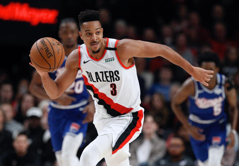 Portland Trail Blazers guard CJ McCollum pushes the ball upcourt against the Sacramento Kings during the first half of an NBA basketball game in Portland, Ore., Saturday, March 7, 2020. (AP Photo/Steve Dipaola)