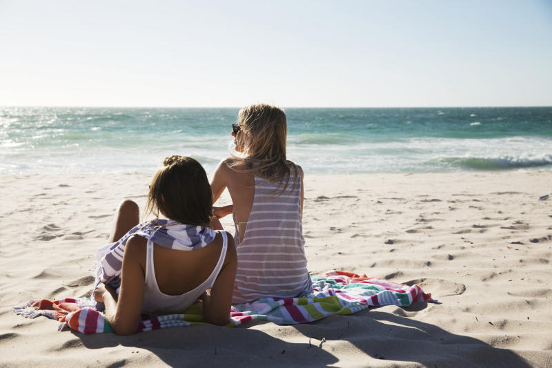 Young women on a beach. Image: Getty