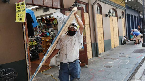 PHOTO: Luis A. Sanabria puts plywood over the windows of a business in the historic French Quarter before the possible arrival of Hurricane Sally on Sept. 14, 2020, in New Orleans. (Joe Raedle/Getty Images)