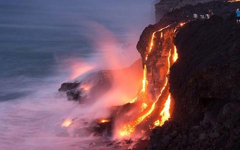 Lava flows from the volcano on Hawaii's east side flow directly into the sea - Credit: Getty