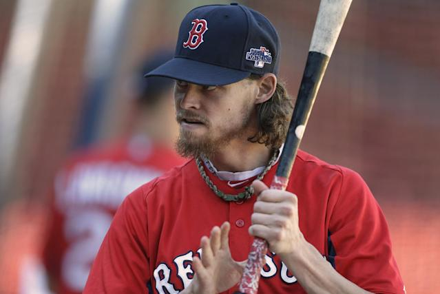 Boston Red Sox's Clay Buchholz grips a bat during a baseball team workout on Tuesday, Oct. 1, 2013, at Fenway Park in Boston. The Red Sox host Game 1 of the AL divisional series on Friday, Oct. 4, against the winner of Wednesday's wild-card playoff game between the Cleveland Indians and Tampa Ray Rays. (AP Photo/Steven Senne)