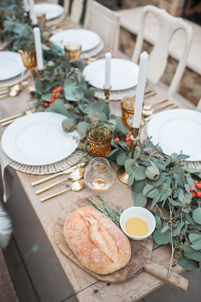 "<p>Allow the center of your table to shine on Thanksgiving Day by paring back your dinnerware and contrasting the greenery with warm metallics.</p><p><a class=""body-btn-link"" href=""https://www.andeelayne.com/our-thanksgiving-tablescape.html""><strong>See more at Andee Layne</strong></a></p>"