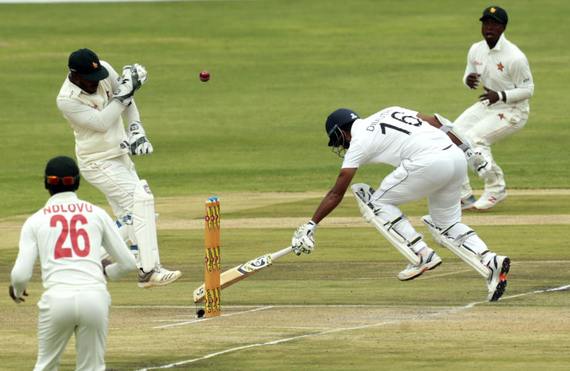 "Sri Lanka batsman Dimuth Karunaratne,right, avoids a run out during the test match against Zimbabwe at Harare Sports Club, Monday, Jan,20, 2020.Zimbabwe is playing in its first international match since the International Cricket Council lifted the country""s ban last year(AP Photo/Tsvangirayi Mukwazhi)"