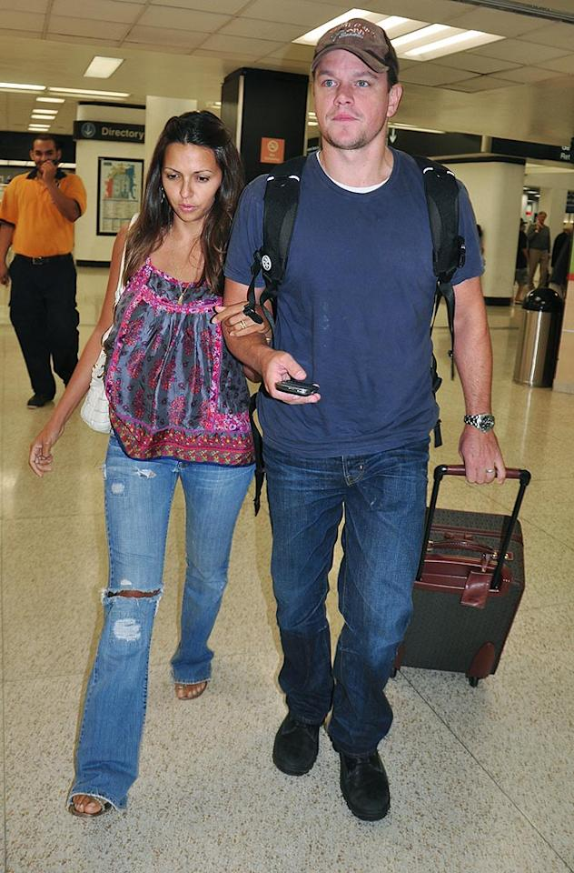 "Matt Damon and wife Luciana Barroso were bound for sunnier climes yesterday, landing in Miami. Though the actor does have a residence in New York, he spends most of his time at home in Florida, where he and Barroso are raising three kids. <a href=""http://www.infdaily.com"" target=""new"">INFDaily.com</a> - July 22, 2009"