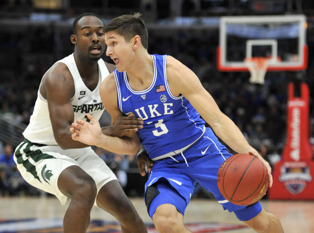 "Duke guard <a class=""link rapid-noclick-resp"" href=""/ncaab/players/126159/"" data-ylk=""slk:Grayson Allen"">Grayson Allen</a> (3) drives on Michigan State guard Joshua Langford during the first half of an NCAA college basketball game Tuesday, Nov. 14, 2017, in Chicago. (AP Photo/Paul Beaty)"
